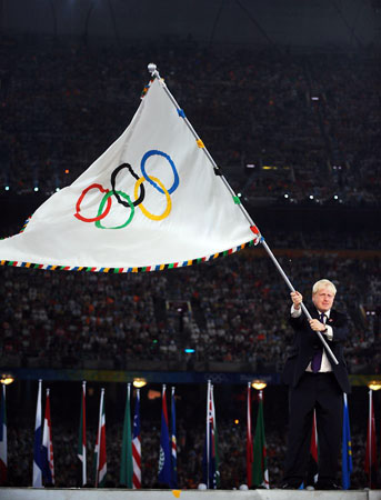 Boris Johnson waves the Olympic flag or IS it Boris Johnson???