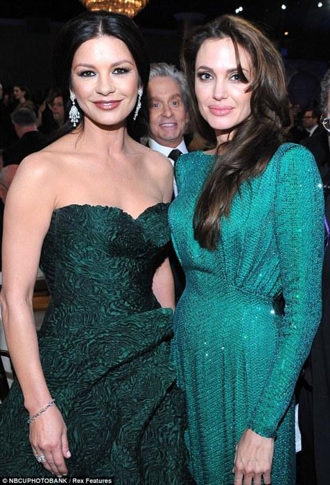 Michael Douglas Photobombs Catherine Zeta Jones and Angelina Jolie