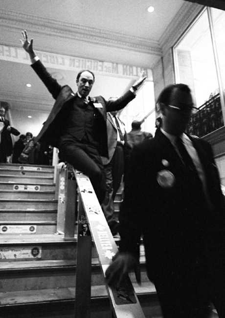 Prime Minister Pierre Trudeau slides down a banister at the Chateau Laurier, Ottawa