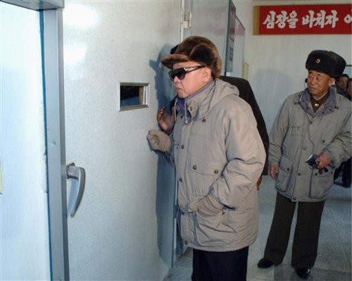 Kim Jong Il looks into the mouth of hell
