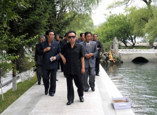 Kim Jong Il poses beside the Styx