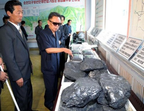 Kim Jong Il looking at coal