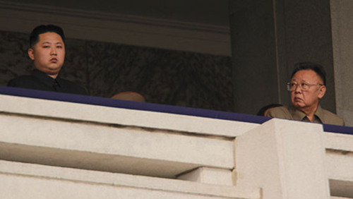 Kim Jong Il looking at Kim Jong Un