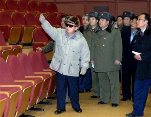 Kim Jong Il waves to his assembled fans